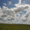 Nuvole sul mare verde